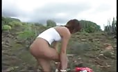 Teen brunette shitting in the mountains