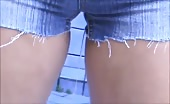 Peeing into her jeans