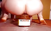 She filled a nutella Jar with poop