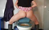 Amateur school girl shitting over a toilet