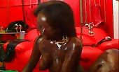 Black cam girl smearing black shit on her face