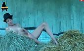 Petite brunette peeing inside a barn