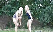 Two Swedish girls peeing outdoor on the ground