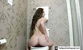 Brown haired teen pooping in reverse position