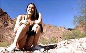 Beautiful brunette peeing outdoor