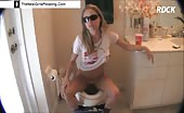 Blonde teen pooping in toilet