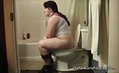 Chubby British babe shitting in toilet