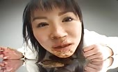 Brunette Japanese smears poop on her face