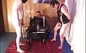 Two hot babes shitting on male slave