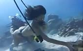 Two girls pooping underwater