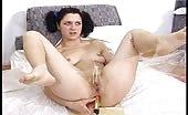 Peeing on her dildo