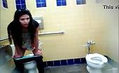 Brunette latina shitting in a public bathroom