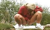 Blonde shitting girl outdoor