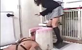 Beautiful secretary pooping on a male slave