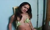 Sexy brunette Brazilian girl in green lingerie shitting