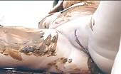 Hot brunette smearing poop on her naked body