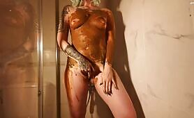 Tattooed alternative girl smears fresh shit